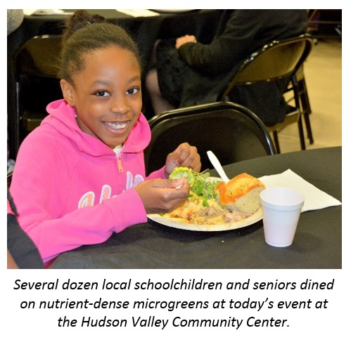 Image: Child dining on nutrient dense microgreens at today's event at Hudson Valley Community Center