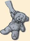 Child's hand holding teddy bear